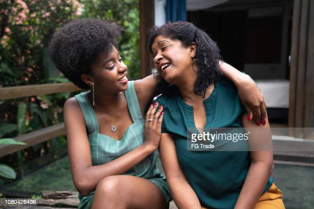 mother and daughter embracing at home - afro caribbean ethnicity stock pictures, royalty-free photos & images