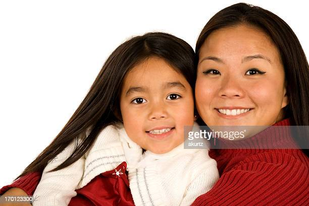 Mother and daughter embracing Korean beautiful miced race girl isolated