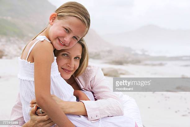Mother and Daughter Embracing on Beach