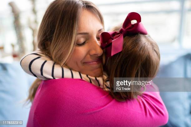 mother and daughter embracing - mothers day stock pictures, royalty-free photos & images