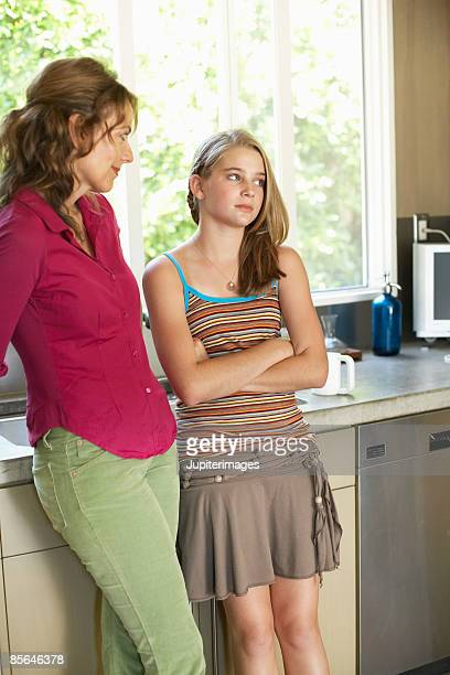 Mother and daughter engaged in awkward conversation
