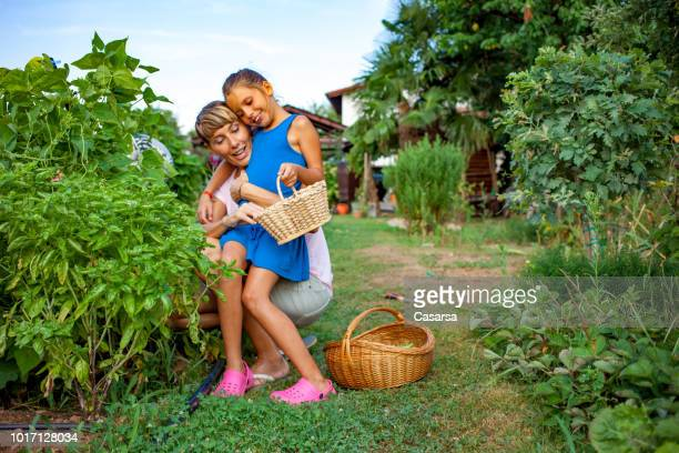Mother and Daughter enjoy in the vegetable garden