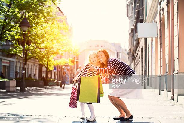 Mother And Daughter Enjoy Shopping Together.