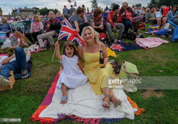 A mother and daughter enjoy the performance during Yorkshire's biggest openair proms of the summer at Castle Howard on August 18 2018 in Malton...