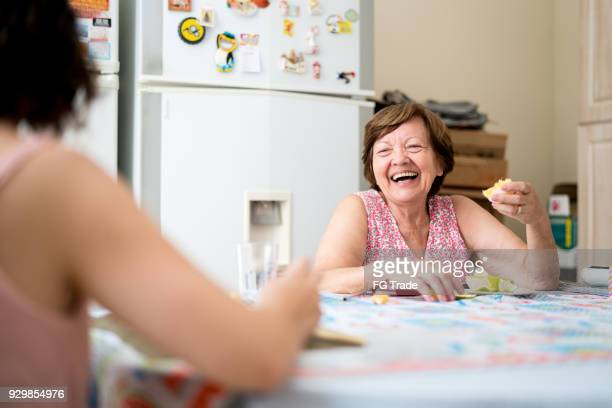 Mother and daughter enjoying a great time together in the kitchen