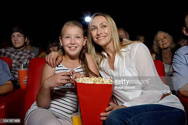 Mother and daughter enjoying a movie