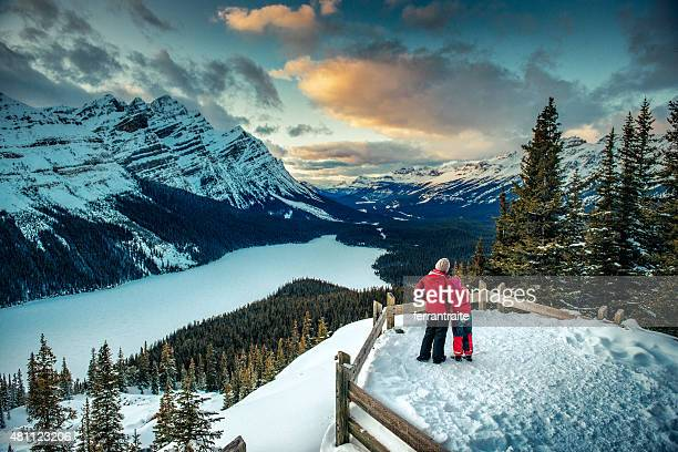 mother and daughter enjoying banff national park in winter - tourism stock pictures, royalty-free photos & images