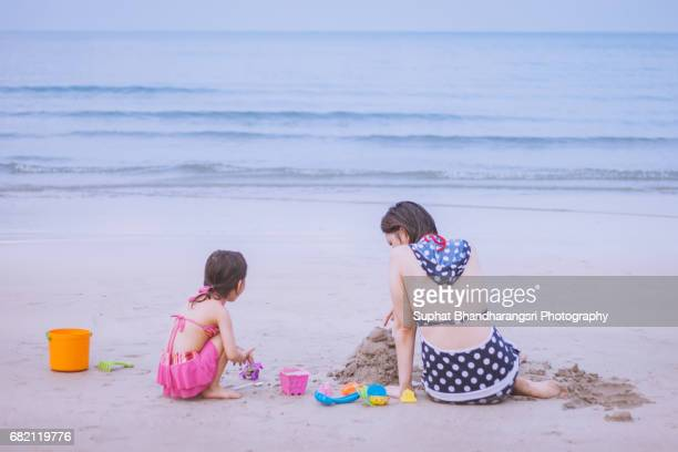 Mother and daughter enjoying beach time