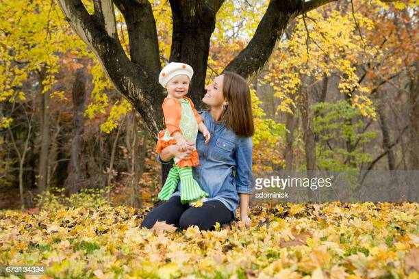 Mother And Daughter Enjoying Fall Day