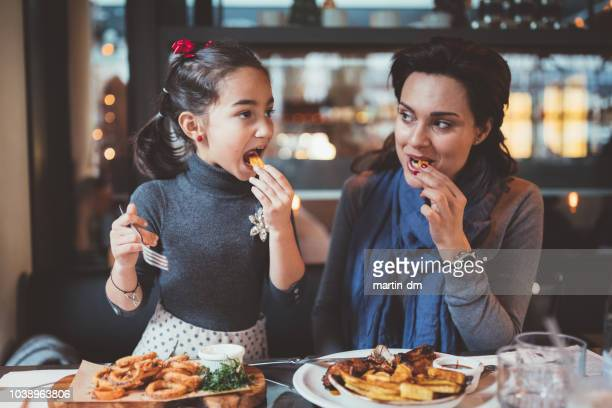 mother and daughter enjoying nice dinner together - the brunch stock pictures, royalty-free photos & images