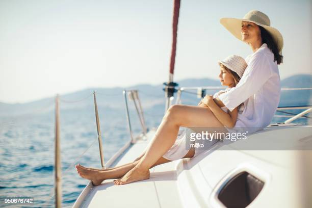 mother and daughter enjoying on yacht - wealth stock pictures, royalty-free photos & images