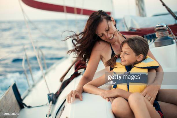 mother and daughter enjoying on yacht - sail stock pictures, royalty-free photos & images