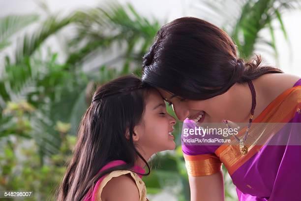 mother and daughter enjoying - mangala sutra fotografías e imágenes de stock