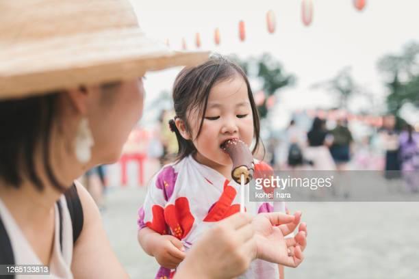 japanese mother daughter wearing yukata enjoying