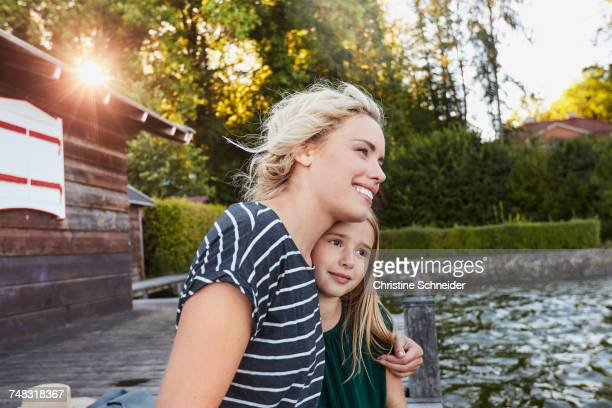 Mother and daughter enjoying themselves by water