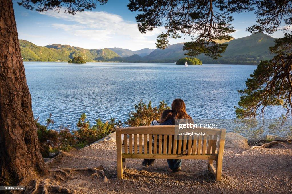 Mother and daughter enjoying view of Lake Derwentwater near Keswick, England : Stock Photo