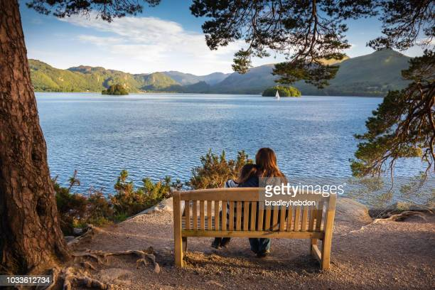 Mother and daughter enjoying view of Lake Derwentwater near Keswick, England