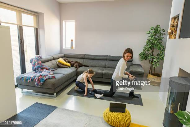mother and daughter exercising at home - net sports equipment stock pictures, royalty-free photos & images