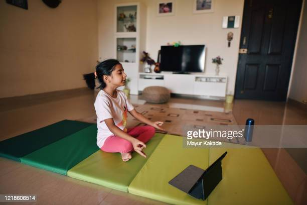 mother and daughter exercising in the living room - homeschool stock pictures, royalty-free photos & images