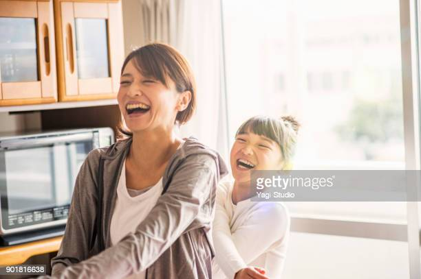 mother and daughter exercising together in home - japanese ethnicity stock pictures, royalty-free photos & images