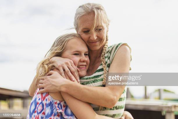 mother and daughter farm life in western usa during serious times - emotional support stock pictures, royalty-free photos & images