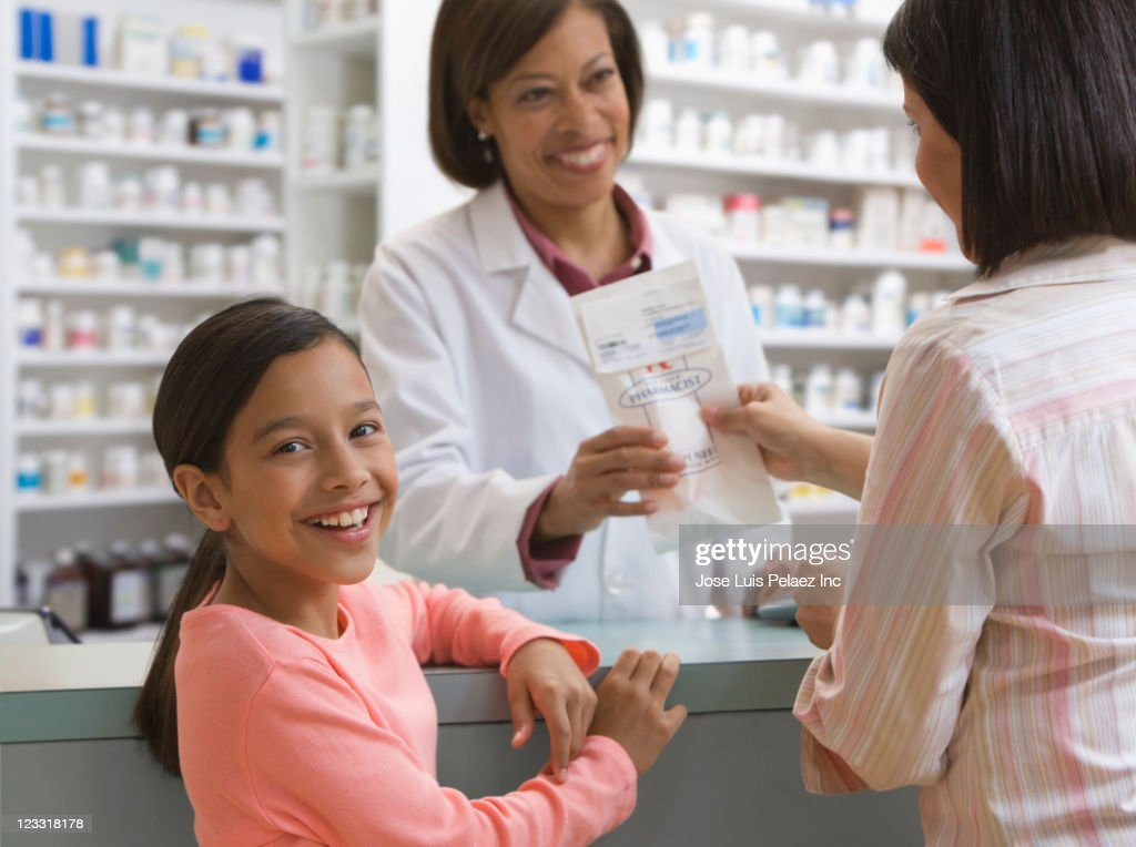88b1436b37c Mother And Daughter Filling Prescription In Drug Store Stock Photo ...