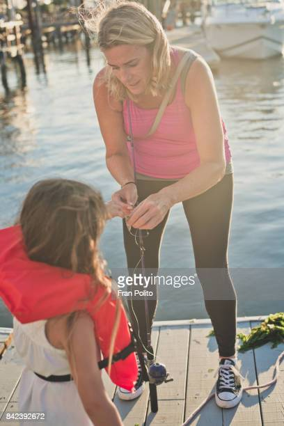 Mother and daughter fishing.