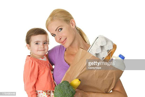 mother and daughter food shopping