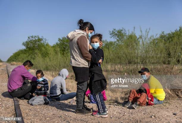 Mother and daughter from Nicaragua embrace after crossing the border from Mexico into the United States on March 26, 2021 in Penitas, Texas. The...