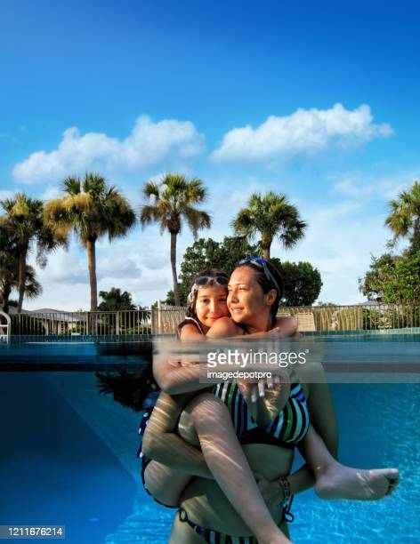 mother and daughter fun in swimming pool - partially sighted stock pictures, royalty-free photos & images