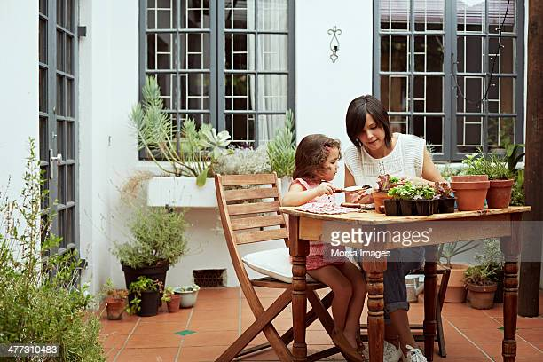 mother and daughter gardening - leanincollection stock pictures, royalty-free photos & images