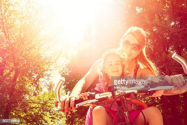 Mother and daughter getting ready for bicycle ride