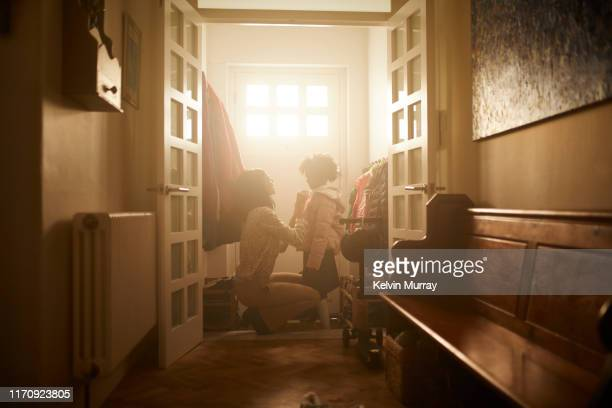 a mother and daughter getting ready to leave the house in the morning. - veste et blouson photos et images de collection