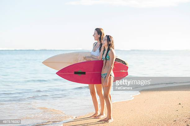 Mother and Daughter Going Surfing