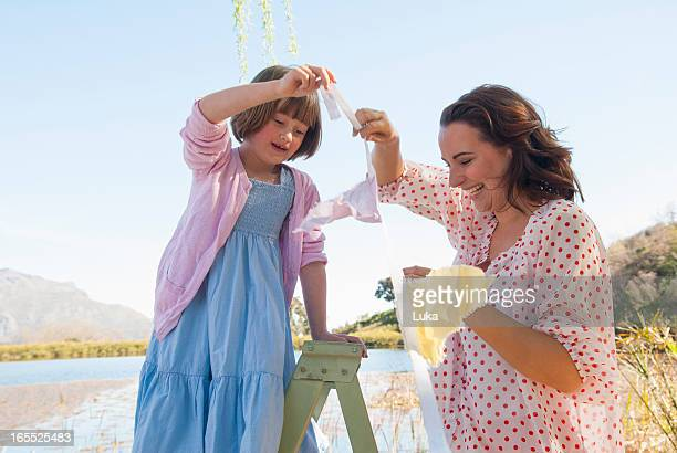Mother and daughter hanging bunting
