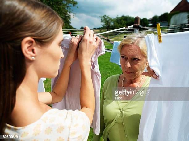 Mother and Daughter Hanging Out Washing