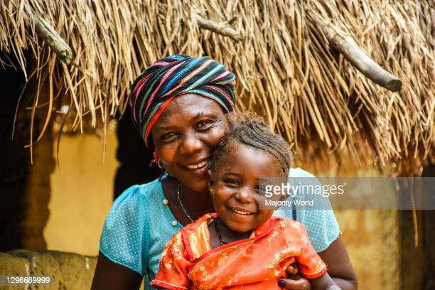 Mother and daughter happily smiling for the camera. Sierra Leone.