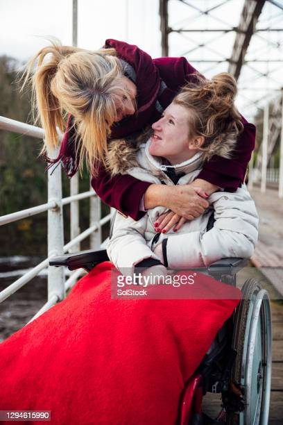 mother and daughter happy on an autumn walk - disability stock pictures, royalty-free photos & images