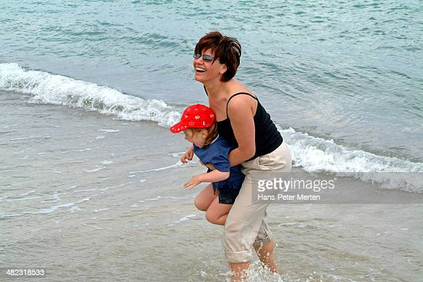mother and daughter have fun on the beach - spaghetti straps stock pictures, royalty-free photos & images