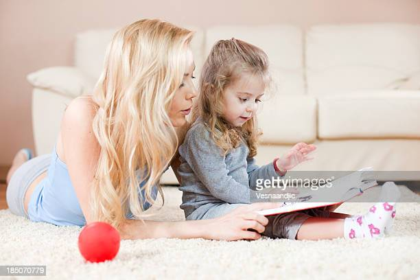 Mother and daughter have fun with story