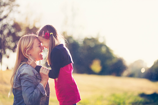 Mother and daughter having a great time in nature 1131014838