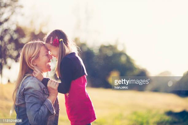 mother and daughter having a great time in nature - mother's day stock pictures, royalty-free photos & images