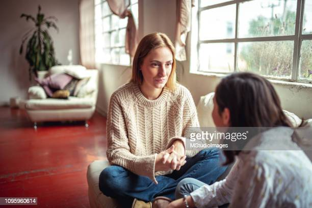 mother and daughter having a talk. - genitori foto e immagini stock