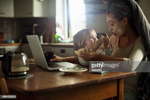 mother and daughter having breakfast - multi tasking stock pictures, royalty-free photos & images
