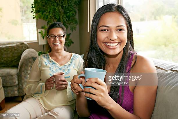 Mother and daughter having coffee together
