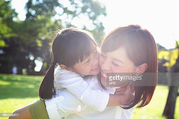 Mother and daughter having fun and smiling