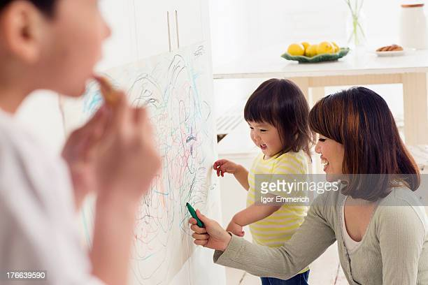 Mother and daughter having fun drawing