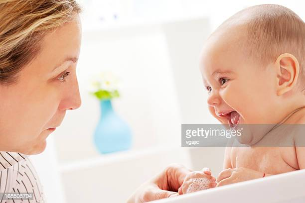 Mother and Daughter Having Fun in Baby Bath