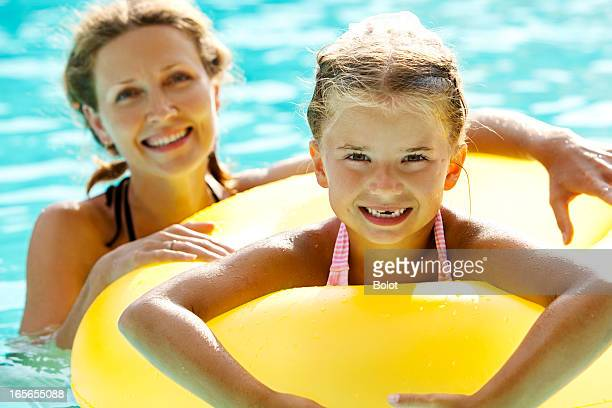 Mother and daughter having fun in pool