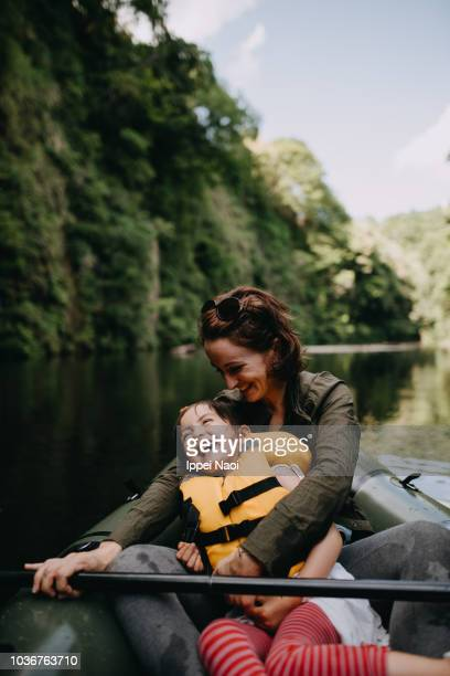 mother and daughter having fun on raft - chiba city stock pictures, royalty-free photos & images